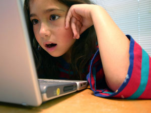 Child viewing a laptop screen