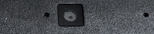 Built-in webcam on laptop - small dark square with dark circle inside
