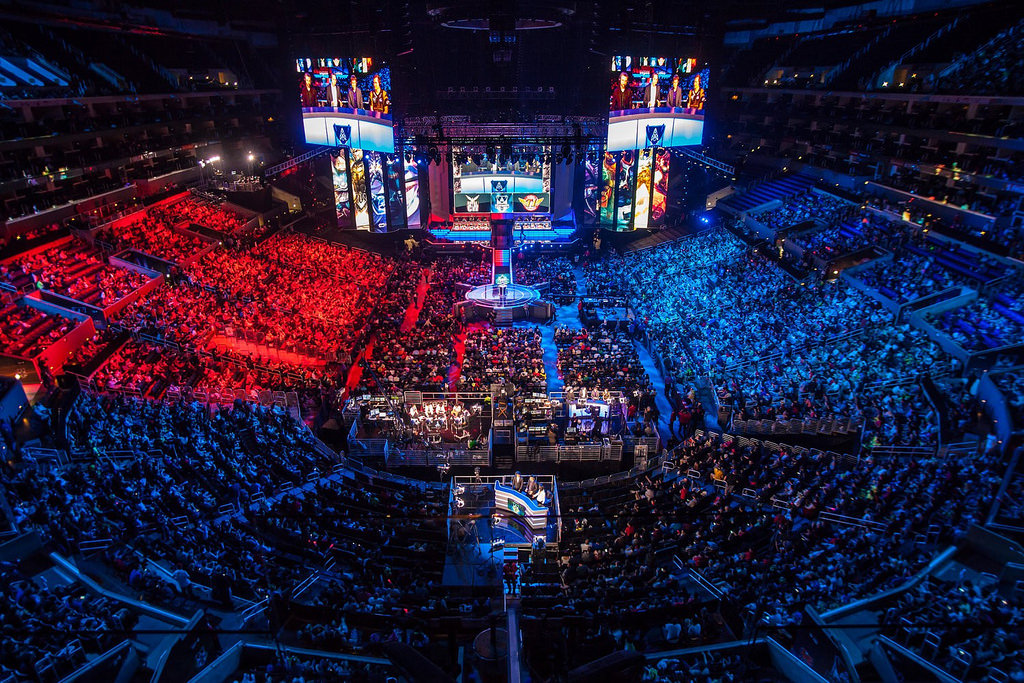 An e-sports tournament fills a stadium.